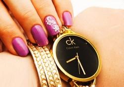 خريد ساعت مچي طلايي دستبندي زنانه