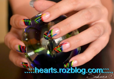 http://rozup.ir/up/hearts/Pictures/colorful-nail-art1.jpeg