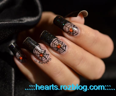 http://rozup.ir/up/hearts/Pictures/halloween-nail-art.jpeg