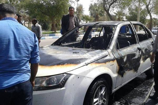 ماجرای آتش زدن ماشین دنا جلوی نمایندگی ایران خودروی ایلام + عکس