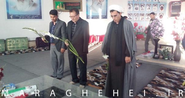 مراسم غبار روبی مزار شهدا با حضور مسئولین شهرستان در روستای آهق برگزار شد