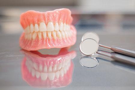 انواع دندان مصنوعی،دندان مصنوعی ثابت