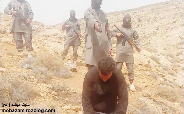 جلاد سیاه پوش داعش مرد سوری را اعدام کرد + تصاویر