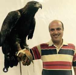 عکس سعيد داخ با يک عقاب